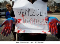 stock-photo-montevideo-july-a-venezuelan-migrant-with-a-sign-that-says-venezuela-agonizes-in-a-703997221